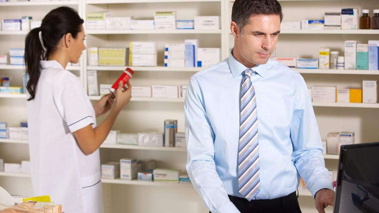 Pharmacists checking medicines in a pharmacy