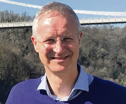 Image of Dr Andrew Tresidder standing outside, close portrait