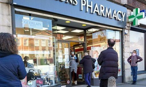 Socially distanced queue outside a pharmacy