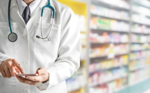 GP on phone in pharmacy